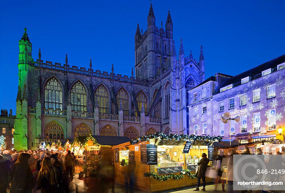 Bath Christmas Market outside Bath Abbey at night, Bath, Somerset, England, United Kingdom, Europe