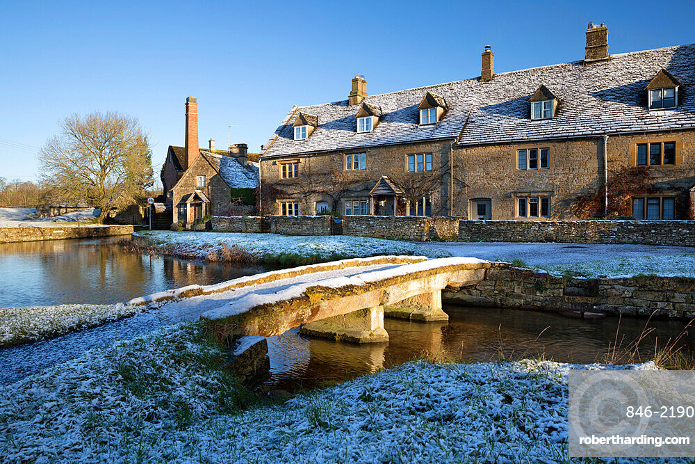 Stone bridge and Cotswold cottages in snow, Lower Slaughter, Cotswolds, Gloucestershire, England, United Kingdom, Europe
