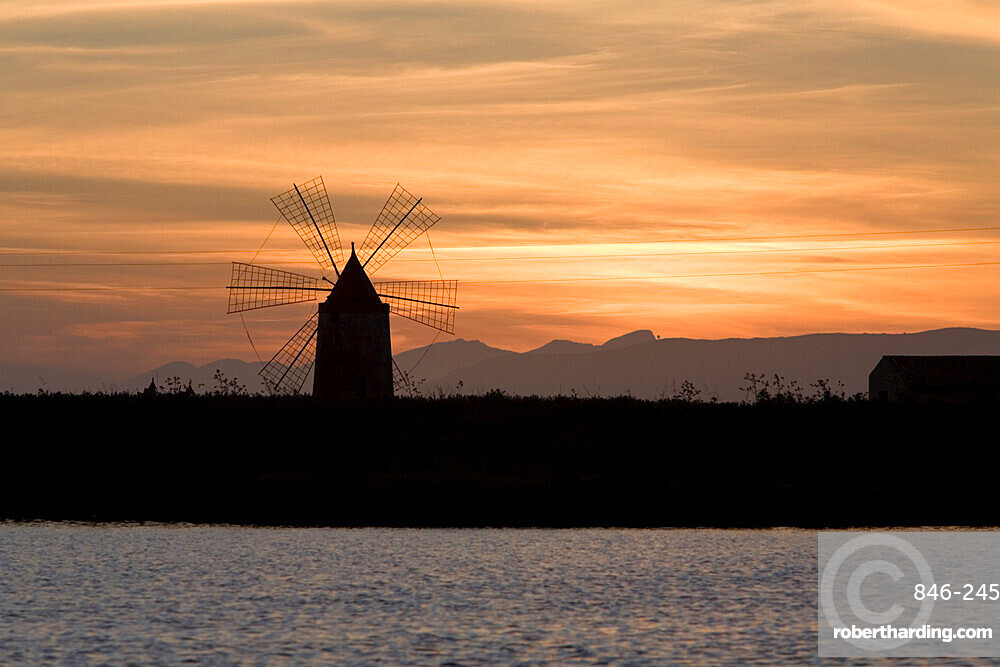 Sunset over windmill on salt beds, Trapani, Sicily, Italy, Mediterranean, Europe
