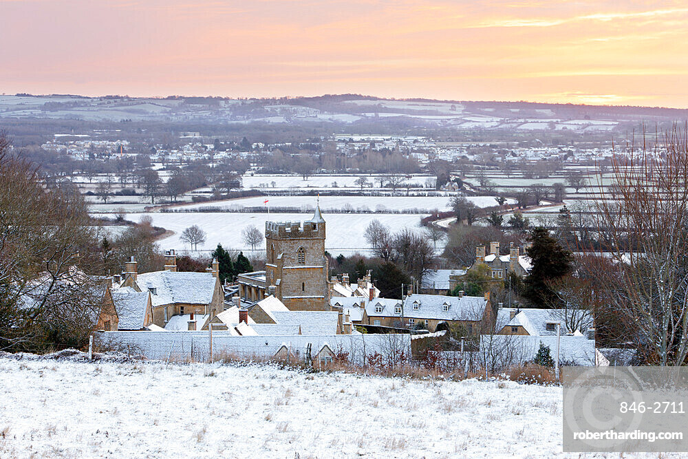 Cotswold village and landscape in snow at sunrise, Bourton-on-the-Hill, Cotswolds, Gloucestershire, England, United Kingdom, Europe