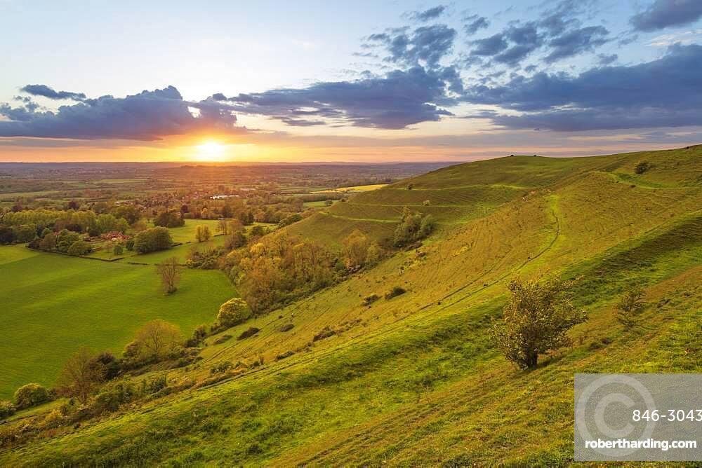 Iron-age hillfort of Hambledon Hill at sunset, Cranborne Chase AONB, Iwerne Courtney (Shroton), Dorset, England, United Kingdom