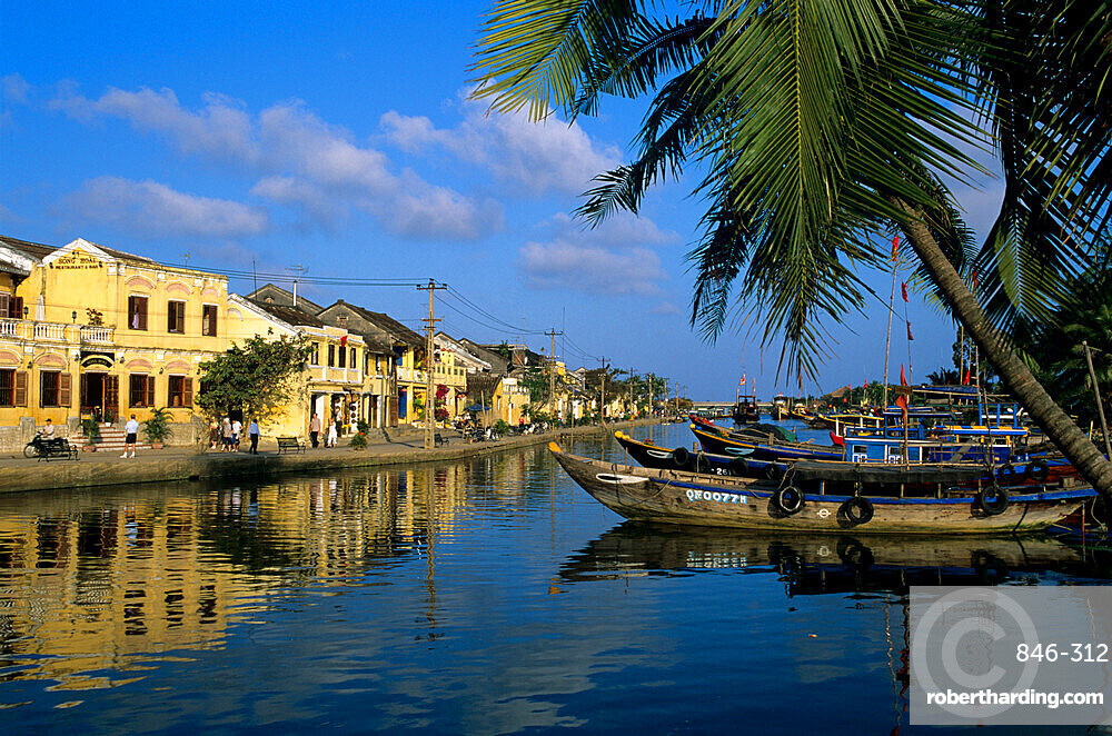 View of old town and fishing boats along Thu Bon River, Hoi An, UNESCO World Heritage Site, South Central Coast, Vietnam, Indochina, Southeast Asia, Asia