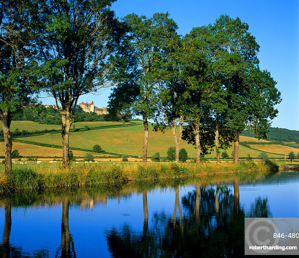 View over the Burgundy Canal to the Chateau, Chateauneuf, Burgundy, France, Europe