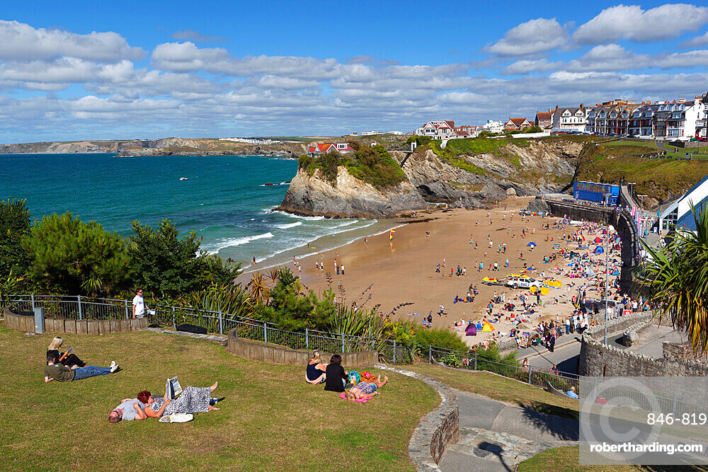 People relaxing in park above Towan beach, Newquay, Cornwall, England, United Kingdom, Europe