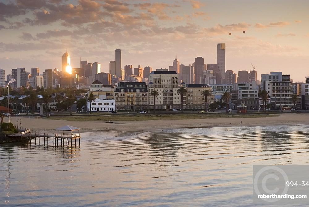 Sunrise over city and beach front, Port Melbourne, Melbourne, Victoria, Australia