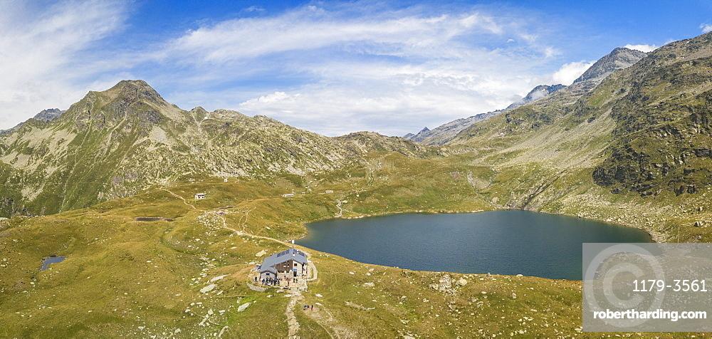 Aerial panoramic of Lake Emet, Rifugio Bertacchi and peak Emet, Spluga Valley, Sondrio province, Valtellina, Lombardy, Italy, Europe