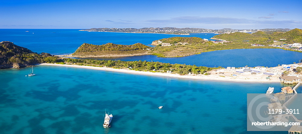 Aerial panoramic by drone of the blue Caribbean Sea and white sand beach, Deep Bay, Antigua, Leeward Islands, West Indies, Caribbean, Central America