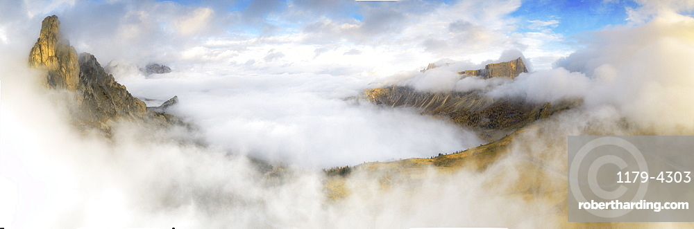 Aerial view by drone of fog over Ra Gusela and Lastoi De Formin in autumn, Giau Pass, Dolomites, Belluno province, Veneto, Italy, Europe