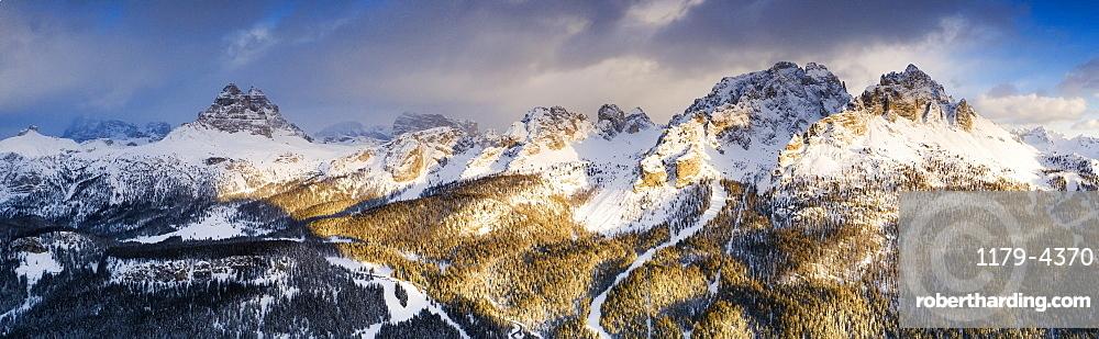 Panoramic of Cadini di Misurina peaks &Tre Cime di Lavaredo at sunset, Dolomites, Auronzo di Cadore, Veneto, Italy (drone)