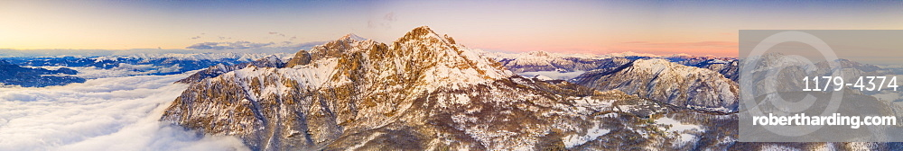 Panoramic of Grigne group during a foggy sunrise, aerial view, Lake Como, Lecco province, Lombardy, Italy