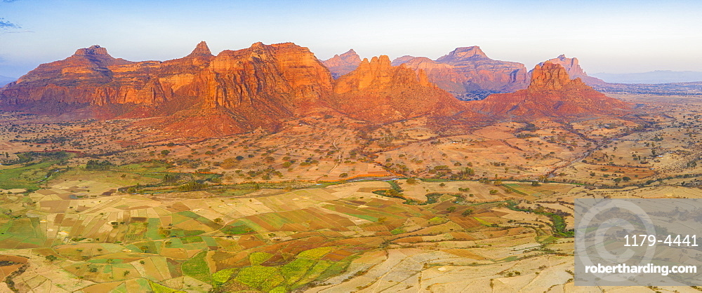 Cultivated fields at feet of the majestic Gheralta Mountains, aerial view, Megab, Tigray Region, Ethiopia, Africa (drone)
