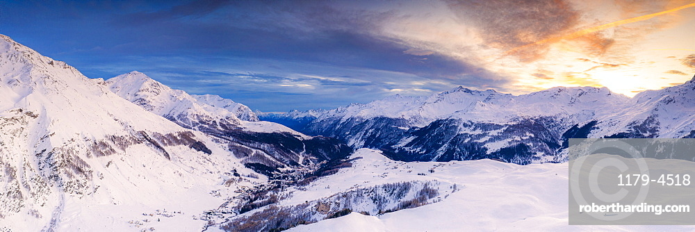 Aerial panoramic by drone of Madesimo and Andossi during a winter sunset, Valchiavenna, Valtellina, Lombardy, Italy, Europe