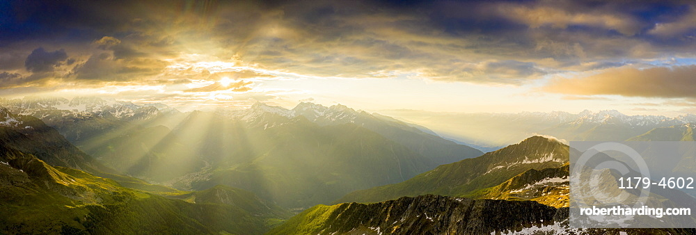Aerial panoramic of Bernina mountain range and Pizzo Scalino lit by sunrise, Valmalenco, Valtellina, Lombardy, Italy