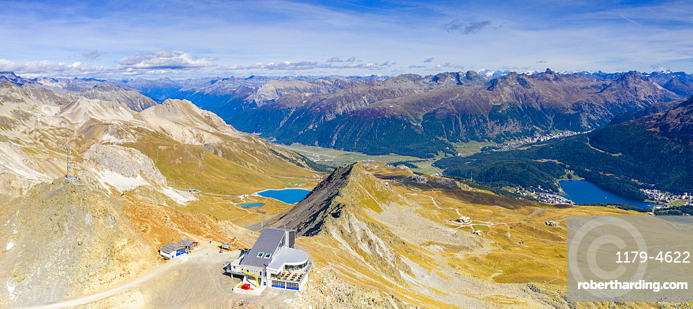 Aerial panoramic by drone of Piz Nair, Lej Alv lake and St. Moritz in background, Engadine, canton of Graubunden, Switzerland, Europe