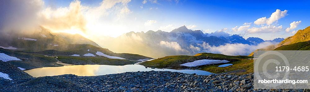 Sunrise over Mittleres Schwarziseeli lake and Galenstock mountain peak in background, Furka Pass, Canton Uri, Switzerland, Europe