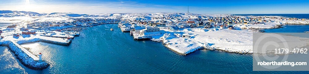 Aerial panoramic of Berlevag village covered with snow and cold Arctic sea, Varanger Peninsula, Troms og Finnmark, Norway, Scandinavia, Europe