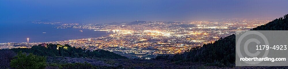 Panoramic of Naples city lights and Gulf at dusk from Vesuvius, Naples, Campania, Italy
