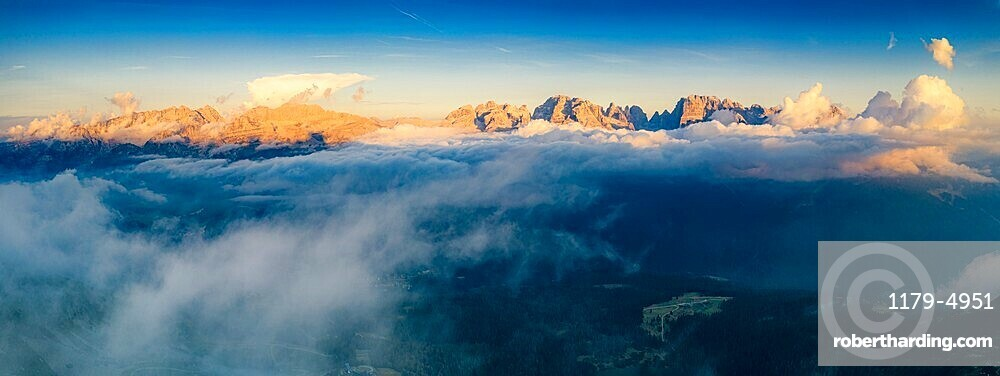 Aerial panoramic view of Brenta Dolomites emerging from clouds, Madonna di Campiglio, Trento, Trentino-Alto Adige, Italy