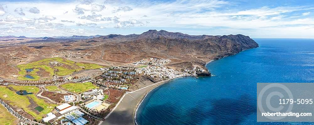 Volcanic beach of the tourist seaside town of Las Playitas, aerial view, Fuerteventura, Canary Islands, Spain