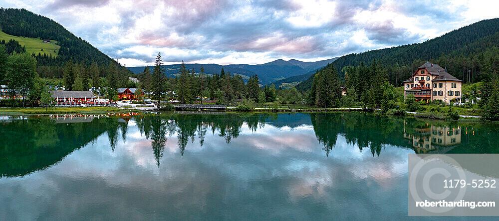 Panoramic of lake Dobbiaco at sunset in summer, Dobbiaco/Toblach, Dolomites, Bolzano province, South Tyrol, Italy