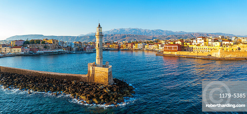 Aerial view of lighthouse and harbour of Chania old town at sunrise, island of Crete, Greece