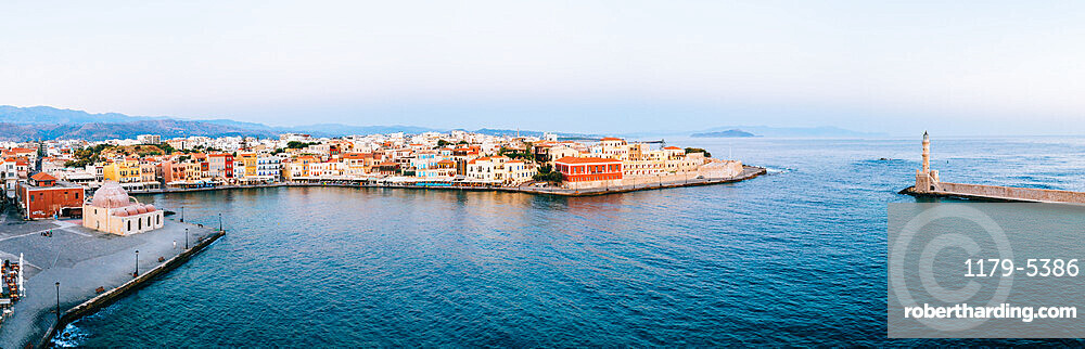 Panoramic of the old Venetian harbour and lighthouse of Chania at sunrise, aerial view, Crete, Greece