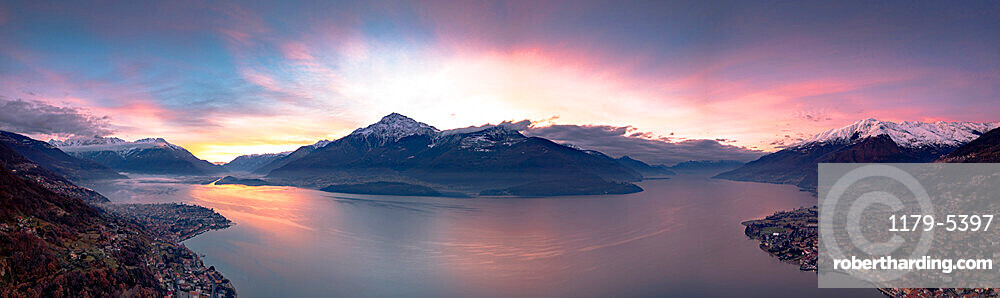 Aerial panoramic view of Gravedona and Domaso towns on shores of Lake Como at sunrise, province of Como, Lombardy, Italy