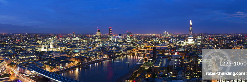 A night-time panoramic view of London and the River Thames from the top of Southbank Tower, showing The Shard and St. Paul's Cathedral, London, England, United Kingdom, Europe