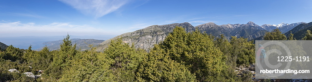 A woman trekking in the Taygetos mountains on the Mani Peninsula in the Peloponnese, Greece, Europe