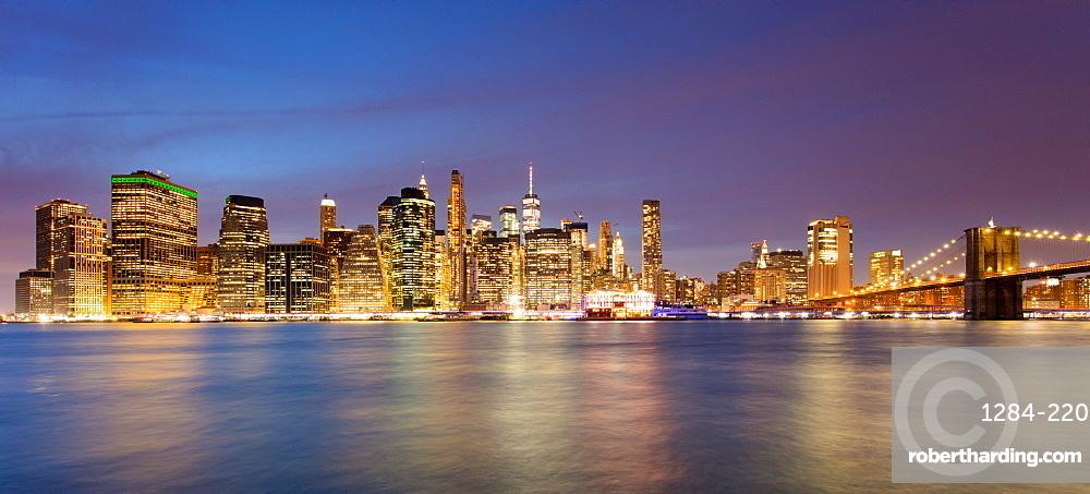 Lower Manhattan skyline and Brooklyn Bridge at dawn, New York City, New York, United States of America, North America
