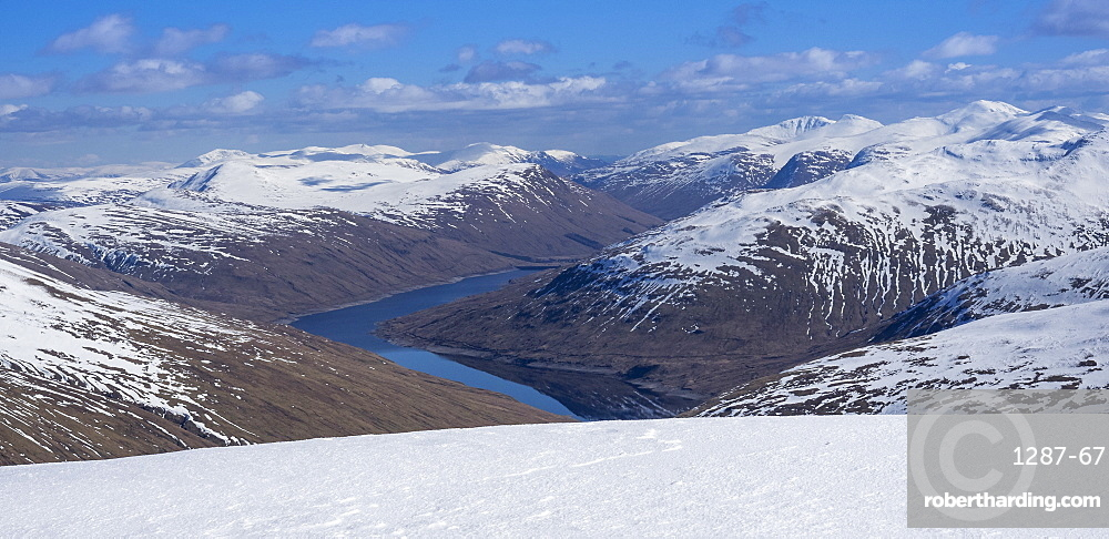 Looking down to Loch Lyon and Glen Lyon from the summit ridge of Beinn Dorain in the Scottish Highlands, Scotland, United Kingdom, Europe