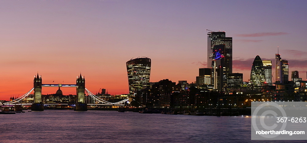 Panoramic view of Tower Bridge framing St. Paul's Cathedral with the City tower blocks at sunset, London, England, United Kingdom, Europe