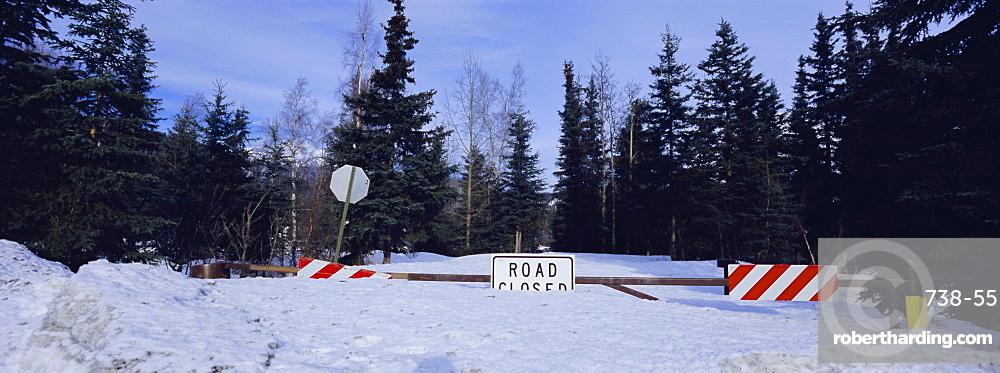Road closed sign and deep snow, Alaska, USA, North America