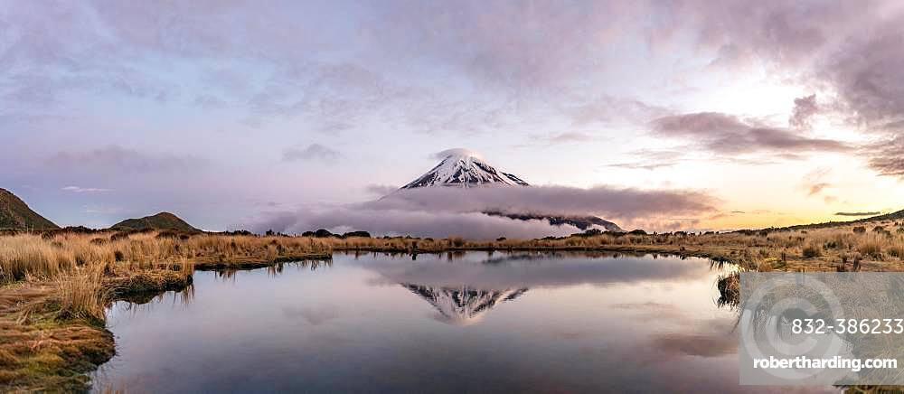 Water reflection in Pouakai Tarn Mountain Lake at sunset, Stratovolcano Mount Taranaki or Mount Egmont, Egmont National Park, Taranaki, New Zealand, Oceania