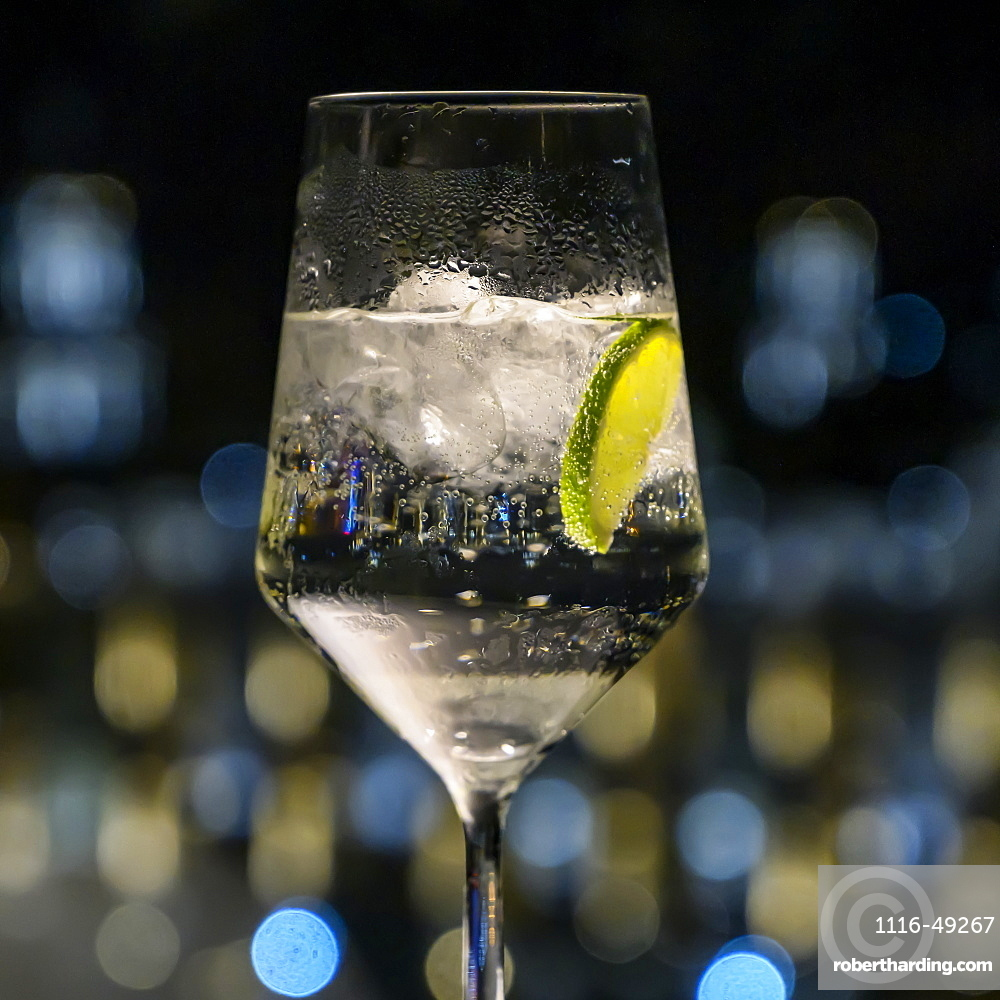 Carbonated water with lime wedge and ice cubes in a glass, Havana, Cuba