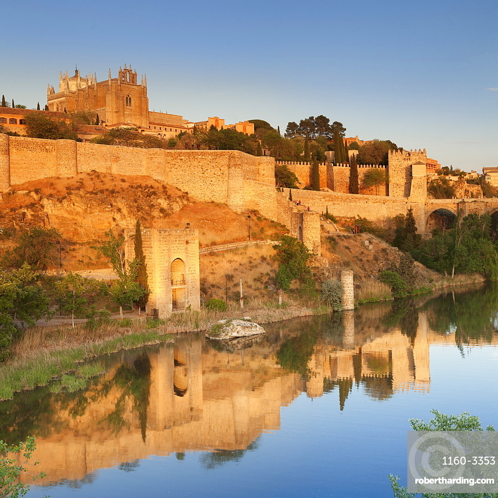 San Juan des los Reyes Monastery and town wall reflected in the Tajo River, Toledo, Castilla-La Mancha, Spain, Europe