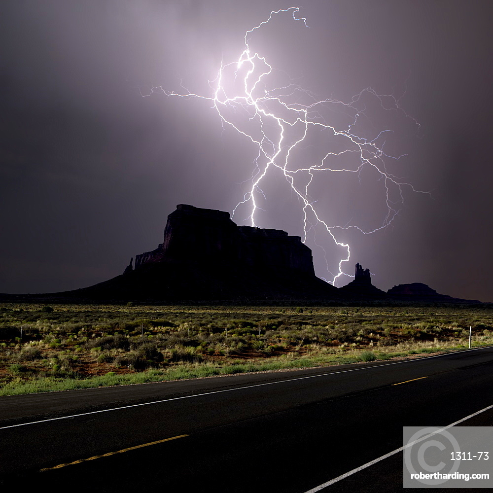 Composite photo of lightning striking behind Eagle Mesa off Highway 163 in 2016, near Monument Valley, Utah, United States of America, North America