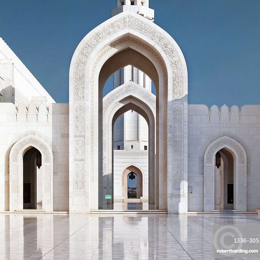 Perspective on arches and minaret of Sultan Qaboos Mosque, Muscat, Oman, Middle East