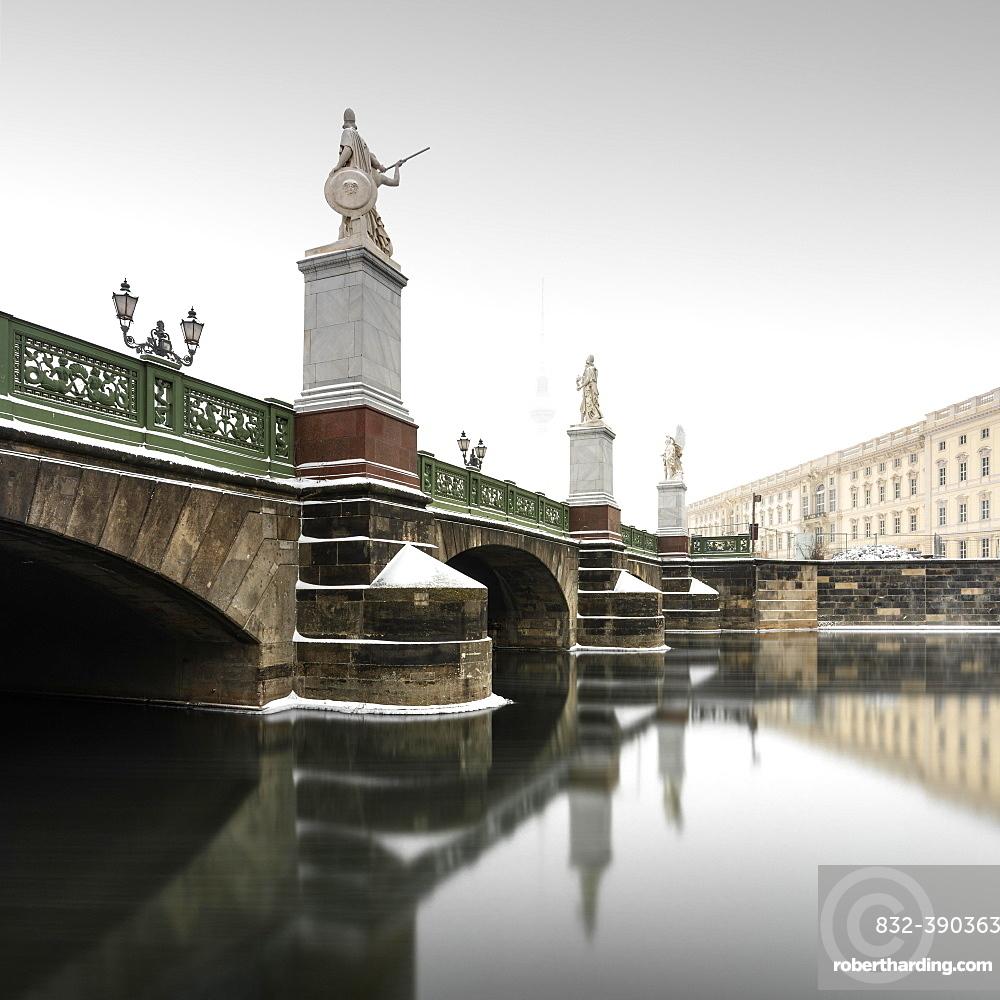 Snowy castle bridge on the museum island, Berlin, Germany, Europe