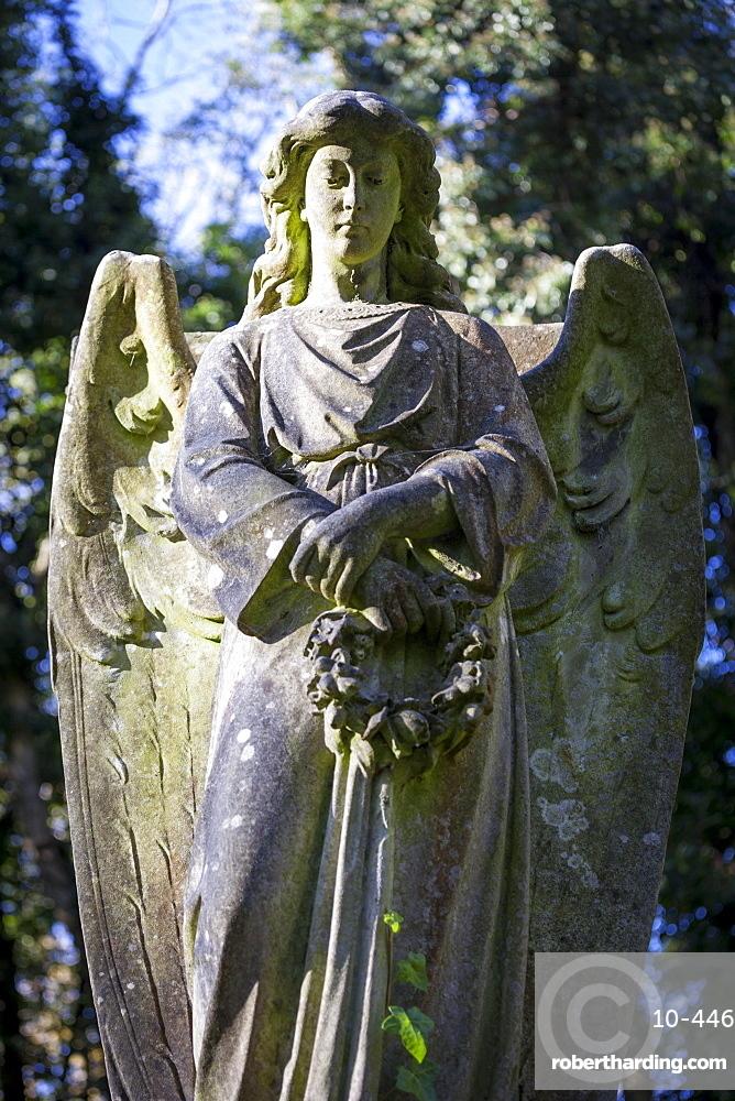 Angel holding wreath, Highgate Cemetery west, London, England, United Kingdom, Europe