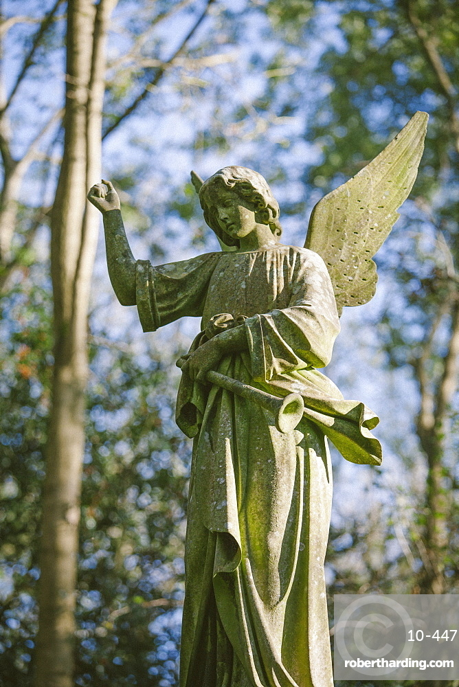 Statue of an angel with a trumpet, Highgate Cemetery west, London, England, United Kingdom, Europe
