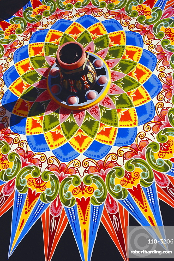 Traditionally painted oxcart wheel, Costa Rica