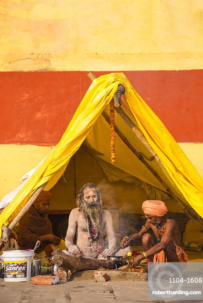 Hindu holy men sitting outside tent, Southern Ghats, Varanasi, Uttar Pradesh, India, Asia