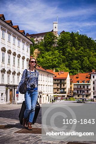 Tourist with suitcase, Ljubljana, Slovenia, Europe