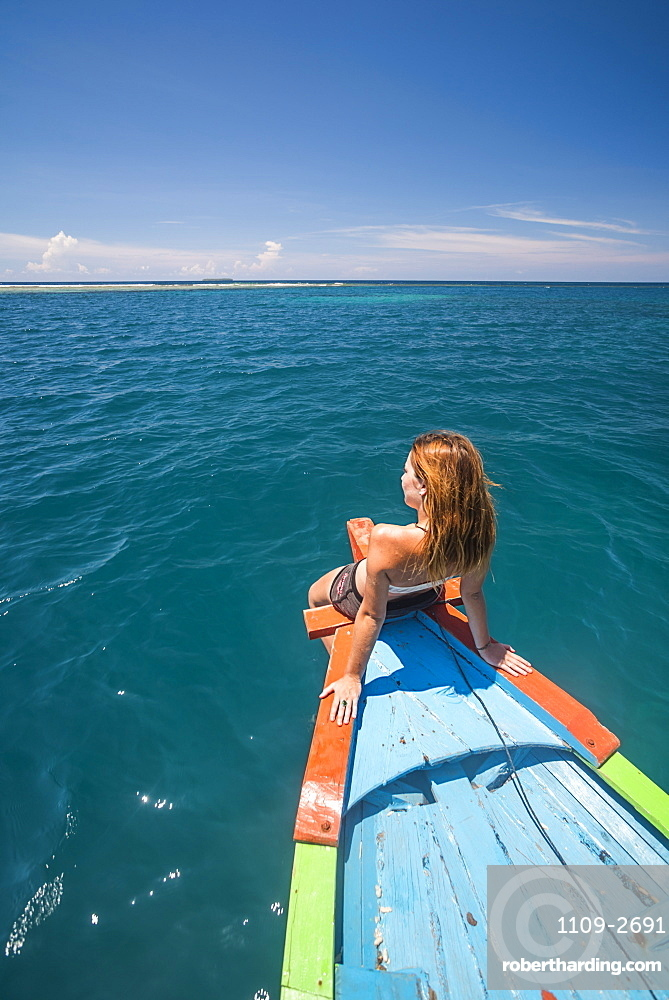 Woman on a traditional Indonesian boat trip to Marak Island near Padang in West Sumatra, Indonesia, Southeast Asia, Asia