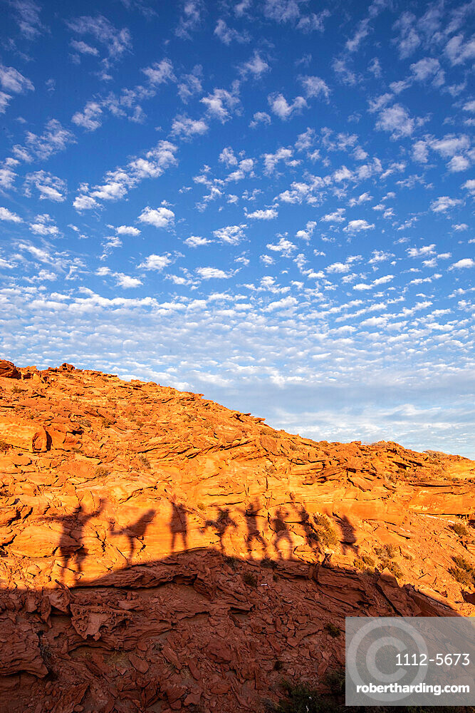 Peoples shadows on wind formed sandstone formations at Los Gatos, Baja California Sur, Mexico, North America.