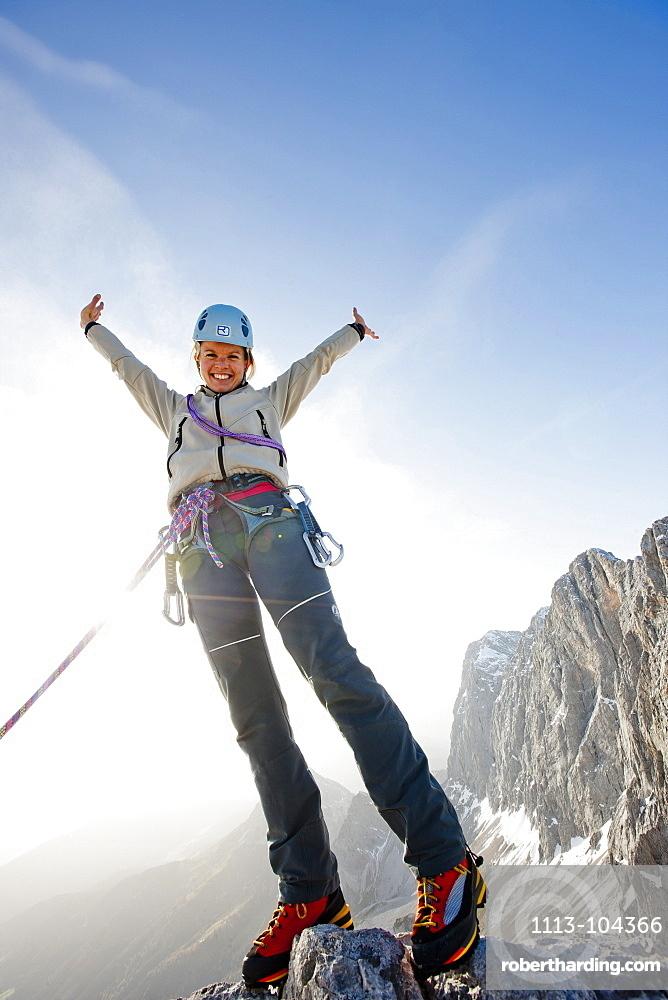 Young woman climbing, Skywalk, Dachstein mountains, Styria, Austria