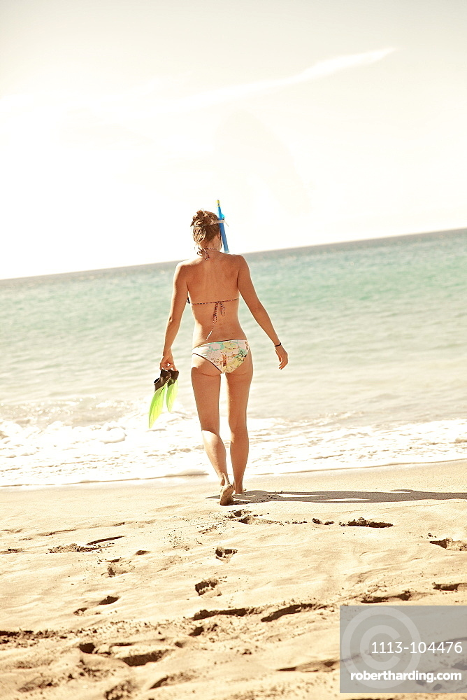 Woman going snorkeling, Praia, Santiago, Cape Verde