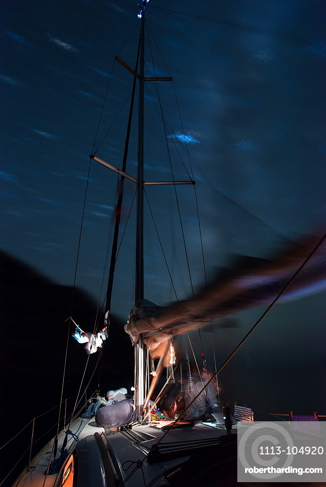 Starry sky above anchoring sailing yacht in a lonely bay on the Greek island Syphnos (Sifnos), Aegean, Cyclades, Greece