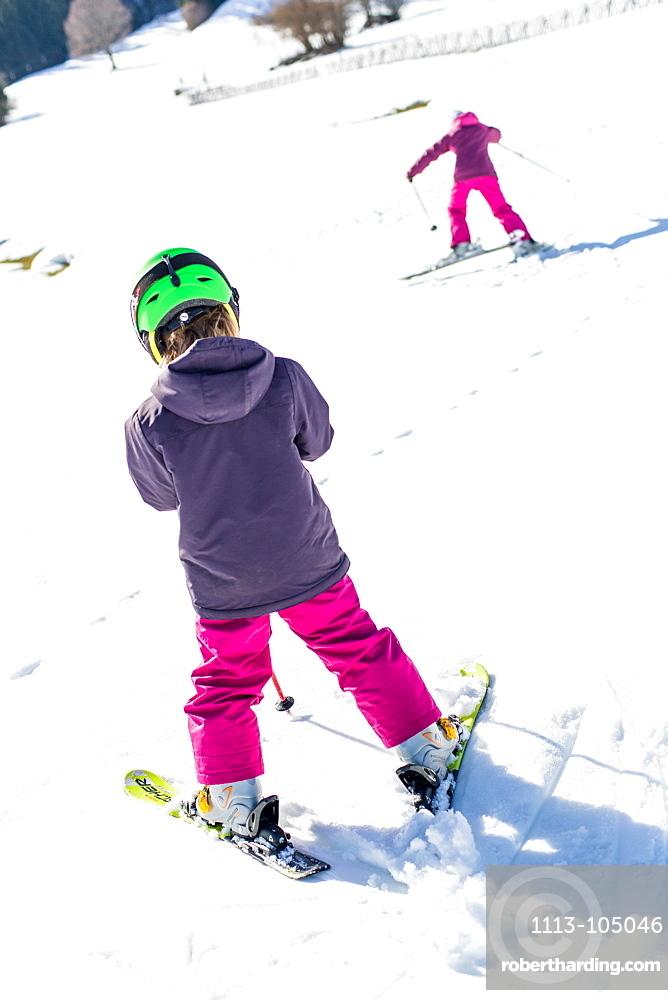 girl and boy during skiing the slope , Pfronten, Allgaeu, Bavaria, Germany